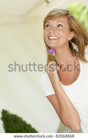 happy woman with flower - stock photo
