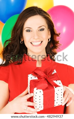 happy woman with gift box and balloons - stock photo