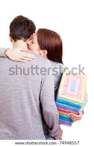 Happy woman with gift thanking her boyfriend with a hug - stock photo