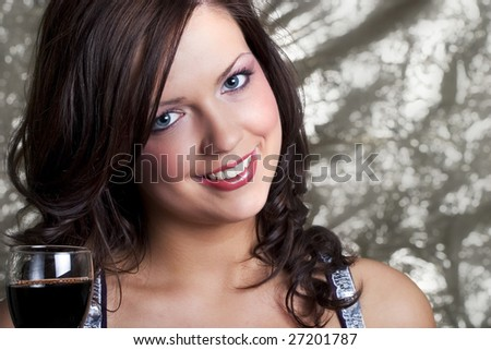 Happy woman with glass of wine - stock photo