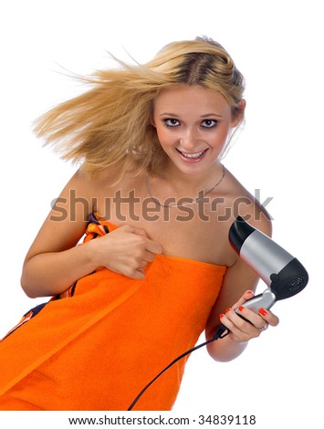 happy woman with hair blower - stock photo