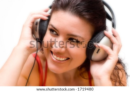 Happy woman with headphones listening to music. - stock photo