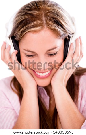 Happy woman with headphones listening to music - isolated over white  - stock photo