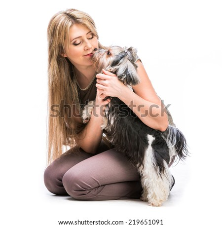 Happy woman with her dog Yorkshire Terrier in studio isolated on a white background - stock photo