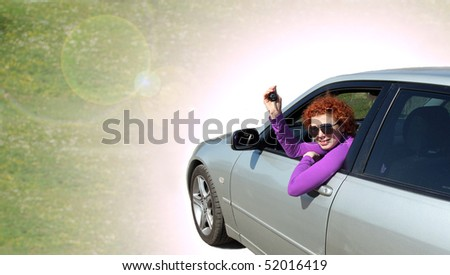 Happy woman with her new car - stock photo