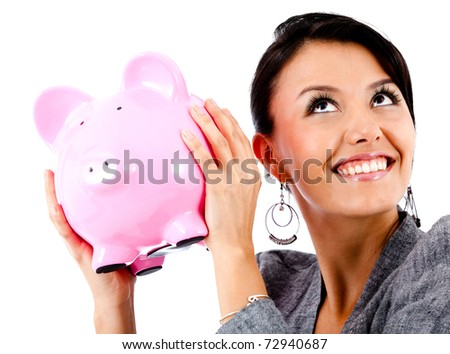Happy woman with her savings in a piggy bank - isolated - stock photo