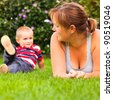 Happy woman with little boy enjoy summer day in the garden. - stock photo
