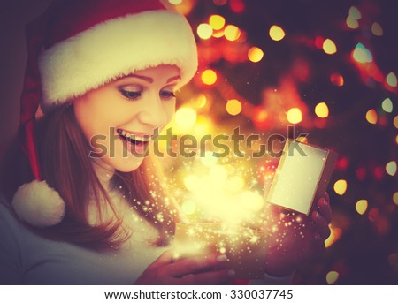 happy woman with magic gifts Christmas  night - stock photo