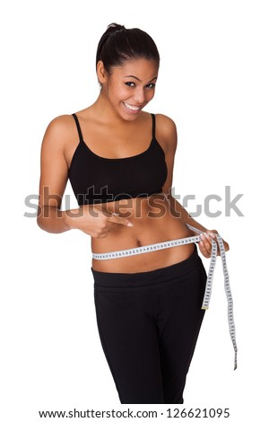 Happy Woman With Measure Tape. Isolated On White - stock photo