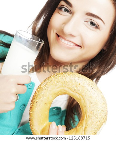 happy woman with milk and donut - stock photo