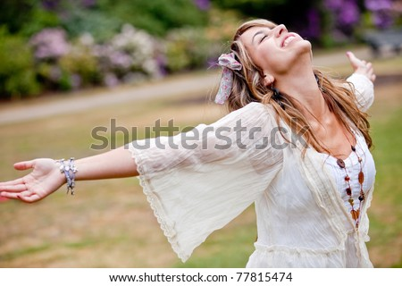 Happy woman with opened arms outdoors enjoy her freedom - stock photo
