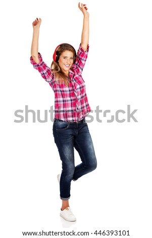 Happy woman with red headphones listening music