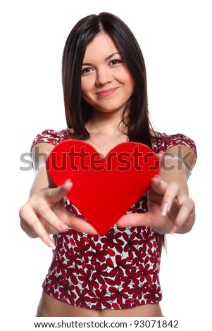 Happy woman with red heart at white background - stock photo
