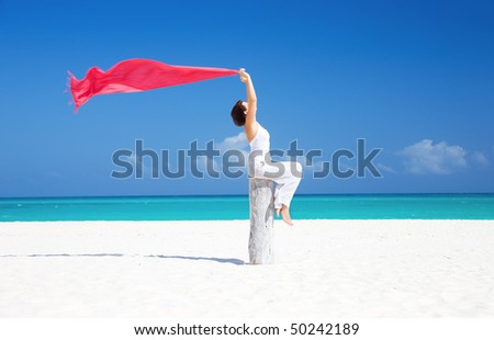 happy woman with red sarong on the beach