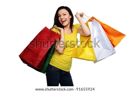 Happy woman with shopping bags isolated on a white background - stock photo