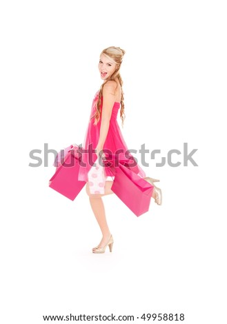 happy woman with shopping bags over white