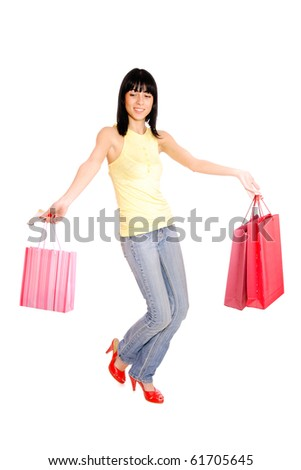 happy woman with shopping bags over white background - stock photo