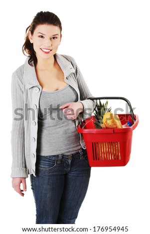 Happy woman with shopping basket , isolated on white background  - stock photo