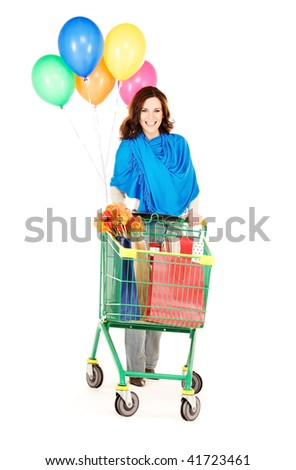 happy woman with shopping cart and balloons over white - stock photo