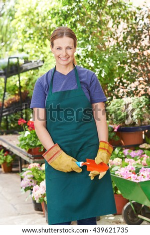 Happy woman with shovel in spring doing garden work