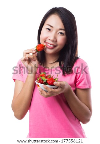 Happy woman with strawberry - stock photo