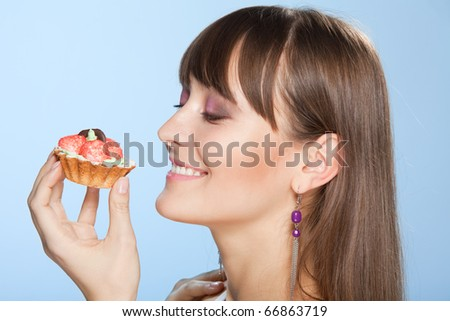 Happy woman with tart cake smiling and admire to eat it