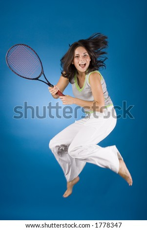 happy woman with tennis racket on the blue background - stock photo