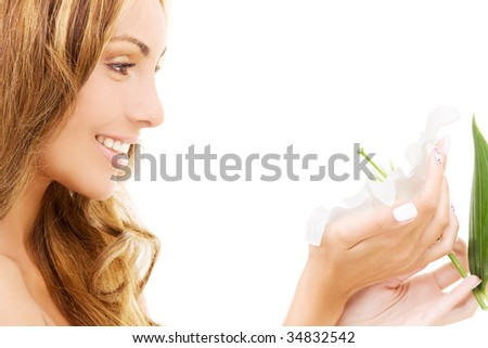 happy woman with white madonna lily flower - stock photo