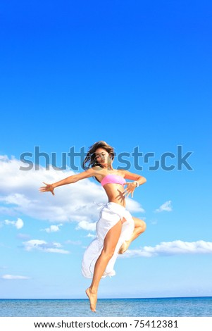 happy woman with white sarong relaxing on the beach - stock photo
