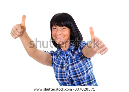 Happy woman with white smile 40 years old in blue checkered shirt, showing thumbs up - isolated on white background, positive human emotion, facial expression