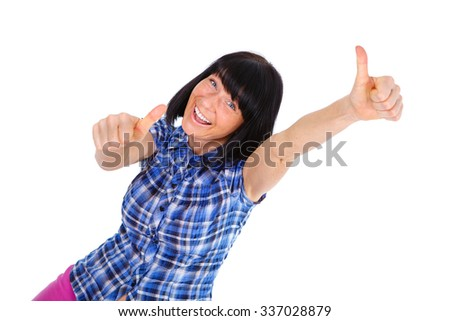 Happy woman with white smile 40 years old in blue checkered shirt, showing thumbs up - isolated on white background, positive human emotion, facial expression - stock photo