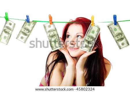 Happy woman won a lottery looking at us dollars on the rope