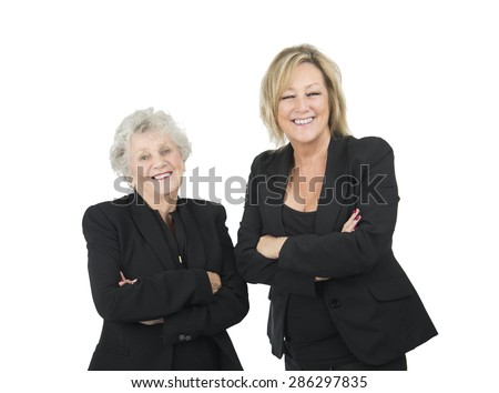 Happy women business partners posing against a white background - stock photo