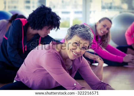 Happy women exercising in fitness studio - stock photo