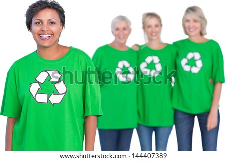 Happy women wearing green recycling tshirts on white background - stock photo