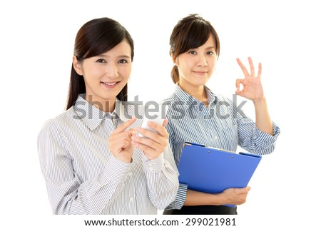 Happy women with a smart phone - stock photo