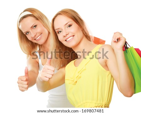 happy women with shopping bags and showing ok isolated on white background