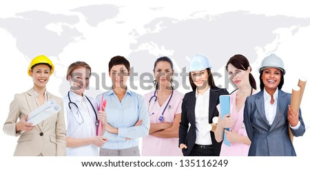 Happy women workers of diverse industries on world map background