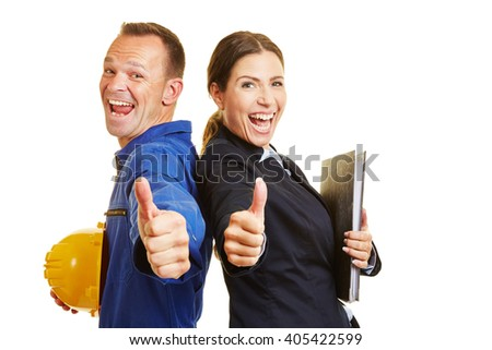 Happy worker and cheering businesswoman holding together their thumbs up - stock photo