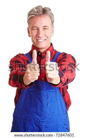 Happy worker holding his two thumbs up - stock photo