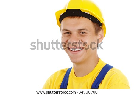 Happy worker wearing hard hat and blue-and-yellow uniform, isolated over white - stock photo