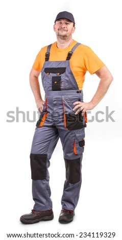 Happy worker wearing overalls. Isolated on a white background.