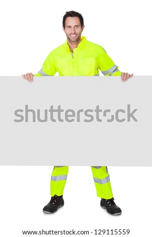 Happy worker wearing safety jacket. Isolated on white - stock photo