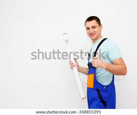 Happy worker with level - stock photo