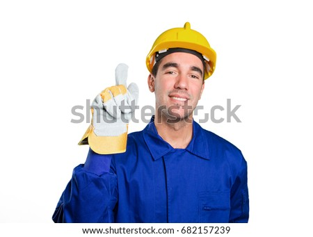 Happy worker with number one gesture on white background
