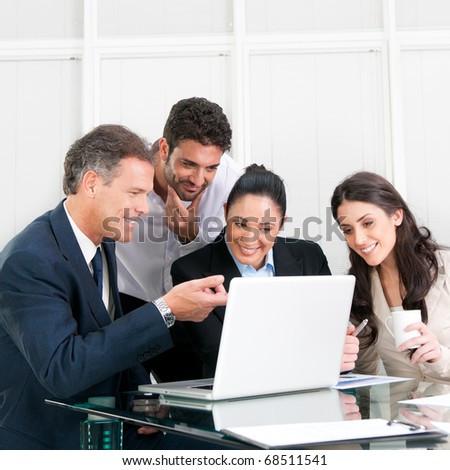 Happy working business team in modern office - stock photo