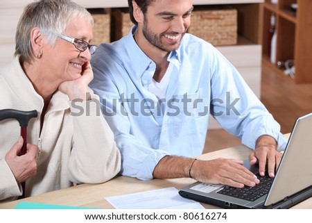 Happy working on the computer at home - stock photo