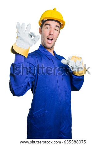 Happy workman doing a gesture of approval on white background
