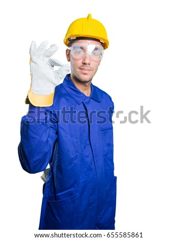 Happy workman with an okay gesture on white background