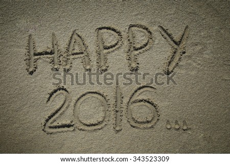 HAPPY 2016 write in a sand at the beach